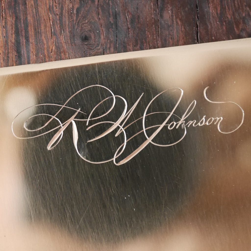 Calligraphie spencérienne gravée à la main